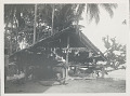 View Pole and Thatch Boat Shed with Carved, Painted Du Yong Handles and Spears Near Water n.d digital asset number 1