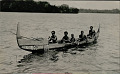 View Group in Costume and Wearing Ornaments, Paddling Painted Canoe on Water digital asset: Group in Costume and Wearing Ornaments, Paddling Painted Canoe on Water