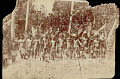 View Group in Costume Wearing Ornaments and in Jungle Clearing; Some Carrying Weapons n.d digital asset number 1