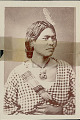 View Portrait of Woman with Hei-Tiki (Amulet) and Feather in Hair digital asset: Portrait of Woman with Hei-Tiki (Amulet) and Feather in Hair