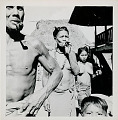 View Igorot man, woman, and girl with body paint and ornaments, outside a frame house, with a boy in the foreground 1959 digital asset number 1