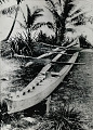 View Samoan Outrigger Canoe and Paddles Near Shore 1924 digital asset number 1