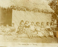 View Group in Costume and with Ornaments Outside Pole and Thatch House with Woven Mat Walls n.d digital asset number 1