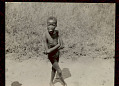 View Young Boy Wearing Breechcloth (Photo Taken from Train) 06 FEB 1925 digital asset number 0