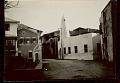 View View of City Street Showing Stucco Church and Decorated Stucco Houses 04 SEP 1925 digital asset number 1