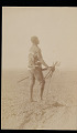 View Man Wearing Animal Skin Costume, Holding Weapons, and Standing n.d digital asset number 1
