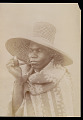 View Portrait of Man Wearing Blanket Robe, Ornaments, and Straw Hat n.d digital asset number 1