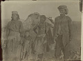 View Aged Woman in Costume, Aged Man, Young Woman and Children Outside Brush Structure in Desert 1899 digital asset number 0