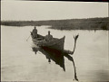 View Two Men in Costume in Dugout Canoe 27 JUL 1925 digital asset number 1