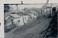View [Manoel in front of fetish house of Omolu (Obaluaiê) with back of main house of Gantois on right], 1938 September digital asset number 2