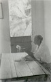 View [Filenha sitting at table in Sabina's home, making lace on frame], 1938 October digital asset number 0