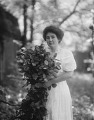 View Unidentified woman holding flowers in Annapolis, Maryland digital asset: Unidentified woman holding flowers in Annapolis, Maryland [glass negative]