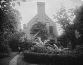 View [Bordley-Randall House]: view of house from College Avenue, with its garden featuring boxwood and banana plants. digital asset: [Bordley-Randall House] [glass negative]: view of house from College Avenue, with its garden featuring boxwood and banana plants.