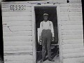View [Miscellaneous Images in Virginia]: an unidentified African-American man standing in a doorway. digital asset: [Miscellaneous Images in Virginia] [nitrate negative]: an unidentified African-American man standing in a doorway.