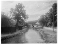 View [Miscellaneous Sites in Shere, Surrey, England, and Vicinity, Series 1]: looking downstream on the River Tillingbourne from the Gomshall Mill, with mill barns or stables on the left. digital asset: [Miscellaneous Sites in Shere, Surrey, England, and Vicinity, Series 1] [glass negative]: looking downstream on the River Tillingbourne from the Gomshall Mill, with mill barns or stables on the left.