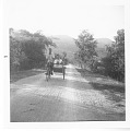 """View Herbert Girton Deignan Papers digital asset: Herbert G. Deignan returning from the mountain (Doi Sutape) in """"rote taxi"""" (bicycle with side car), 1935. Caption includes: """"Note shotgun"""". [Image no. SIA2008-2372]"""