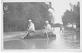 """View Folder 1 Photographs, c. 1916-1960s digital asset: Herbert G. Deignan (right on raft) - Siam, 1930s. Caption: """"This might be called a 'study of types of American knees,' with a few Lao knees in the background for comparison"""". [Image no. SIA2008-2375]"""