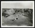 View Charles Lewis Gazin Papers digital asset: Photograph of Charles Lewis Gazin's field work and collecting in Wyoming, 1941. Two tents and a Jeep in the center of image, with mountains in the background. [Image no. SIA2012-2692]