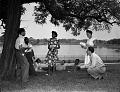 View Mr. Butcher's dramatics class reading outdoors. [Acetate film photonegative.] digital asset: untitled