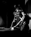 View [Man focusing photographic enlarger : black-and-white photonegative.] digital asset: untitled