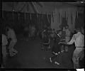 View [Group of men in military uniform dancing with women : cellulose acetate photonegative] digital asset: untitled