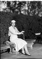 View Mme. Evanti [Lillian Evans Tibbs, sitting on bench in park : acetate film photonegative] digital asset: untitled