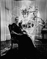 View [Mrs. Vann (?) sitting in chair in parlor with papers : acetate film photonegative.] digital asset: untitled