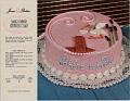 View [Cake, decorated for a baby shower, available for order from Jane Parker, in-store brand name for A&P grocery chain : plastic laminated color lithograph] digital asset: Angel's Express Shower Cake