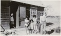 View Lovelock Nevada Indian Community Housing and Relief Aid documentation digital asset: Children standing outside Joe and Leazon Louis' home