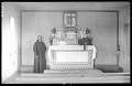 View J. Harold Waugh photographs from the Spirit Lake Reservation (Devils Lake Reservation) digital asset: Priest at a church altar