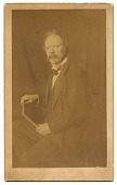 view Unidentified man holding a book digital asset number 1