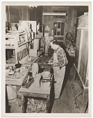 view Salvatore Aucello placing tiles into a mosaic digital asset number 1