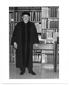 view Romare Bearden in academic robes standing in a library digital asset number 1