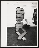 view Claes Oldenburg and one of his works in his show <em>The Street</em> at the Reuben Gallery digital asset number 1