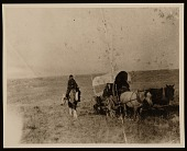 view Native Americans traveling in covered wagon digital asset number 1
