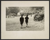 view Pat Adams and Patrick Ball walking in costume towards The Pines dining hall at Penland digital asset number 1