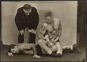 view C.J. Bulliet observing two tattooed wrestlers digital asset number 1