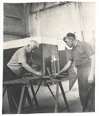 view Alexander Calder and assistant lay out sculpture digital asset number 1