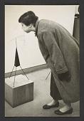 view Photograph of woman blowing on Alexander Calder sculpture digital asset number 1