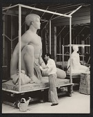 view Brents Carlton doing finishing work on his sculpture <em>Polynesian boy</em> digital asset number 1
