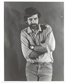 view Ramón Carulla standing with arms crossed digital asset number 1