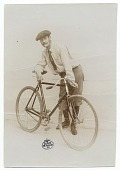 view Lyonel Feininger standing with a bicycle digital asset number 1