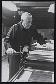 view Photograph of Ed Colker at his Vandercook press digital asset number 1