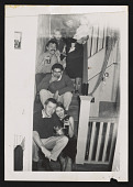view Snapshot of Jay DeFeo and others sitting on interior steps at house on Fillmore Street, San Francisco digital asset number 1