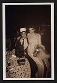 view Colin de Land with an unidentified woman at a party digital asset number 1