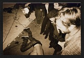 view Unidentified partygoers watching a man on the floor digital asset number 1