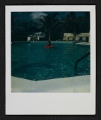 view Unidentified man swimming in a hotel pool digital asset number 1