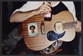 view Spencer Sweeney holding a guitar digital asset number 1
