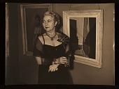 view Edith Gregor Halpert in an evening dress with a painting digital asset number 1