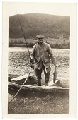 view Frank DuMond standing in a boat digital asset number 1